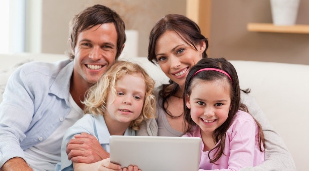 Charming family using a tablet computer in a living room-1-247173-edited