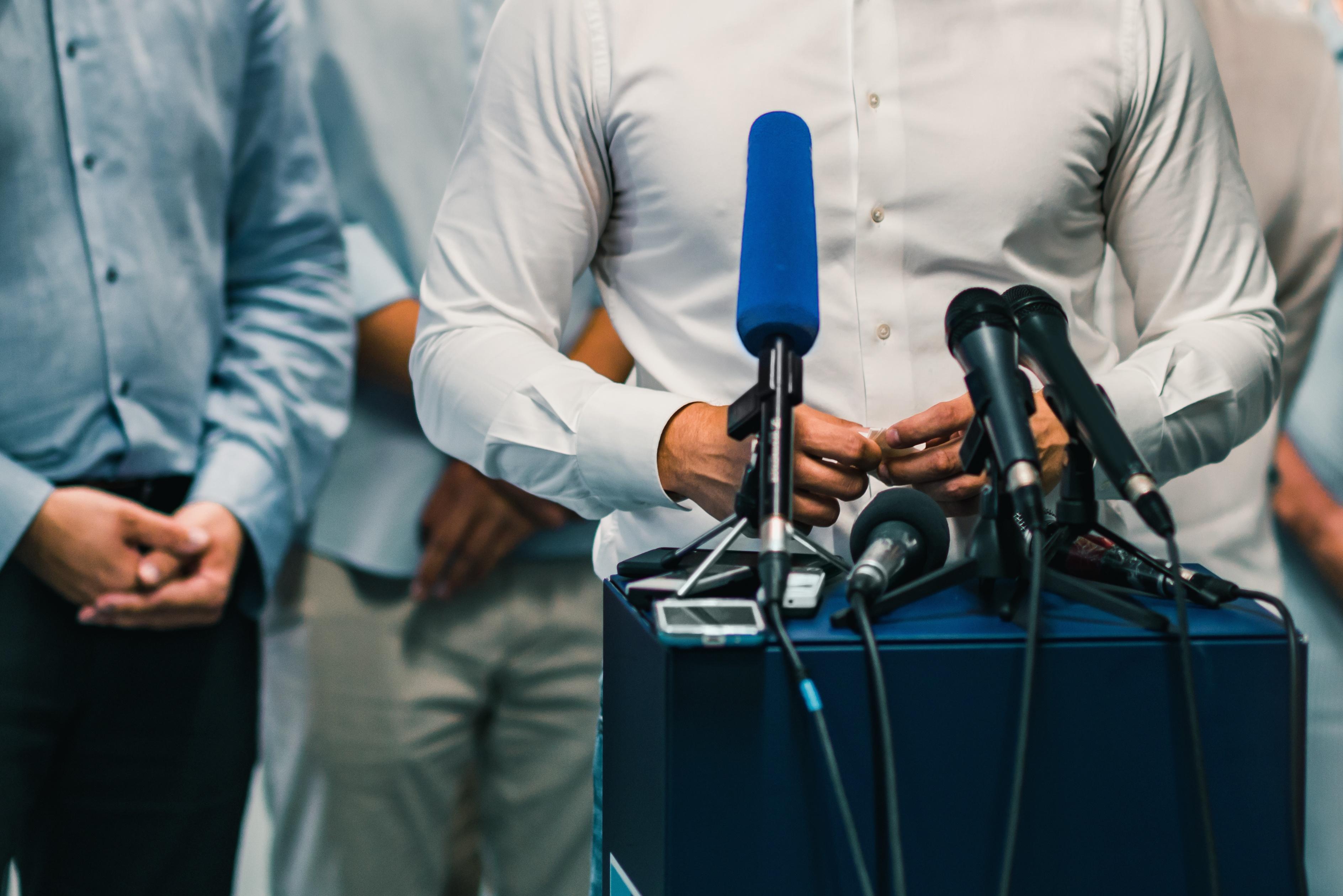 businessman-during-press-conference-PTSUW5K