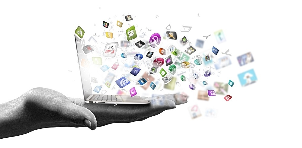 Close up of hand with laptop and media icons-2-176246-edited.jpeg