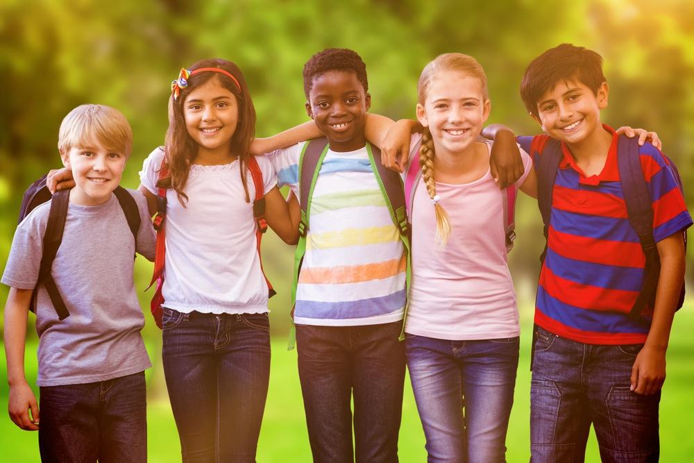 Smiling little school kids in school corridor against trees and meadow-2