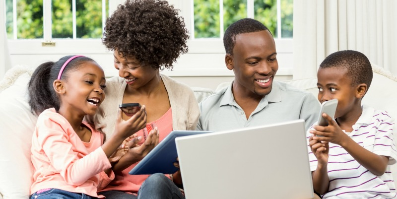 black family with devices.jpg