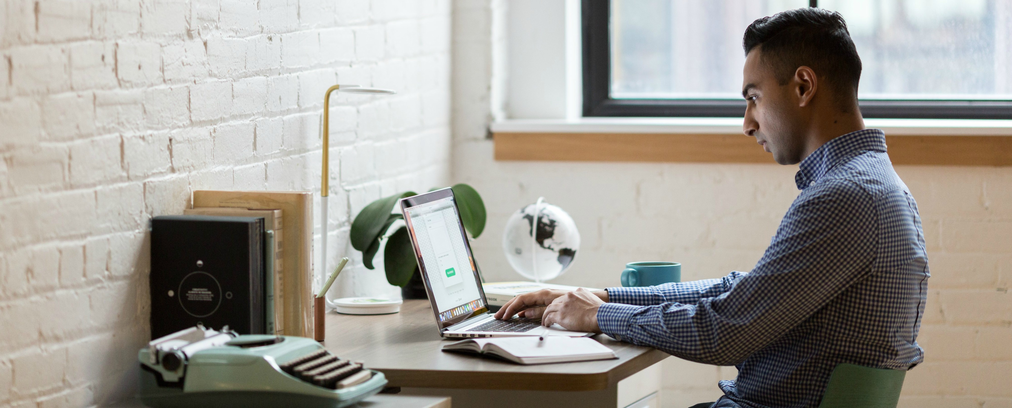 young-man-working-at-desk.jpg